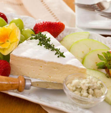 wedge of cheese surrounded by fruit