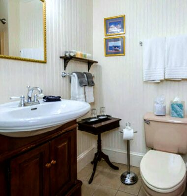 bathroom with stripped wallpaper