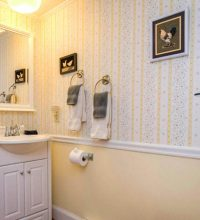bathroom with yellow and white wallpaper