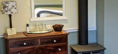 chest of drawers and fireplace