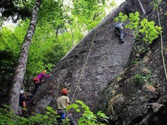 people climbing rock