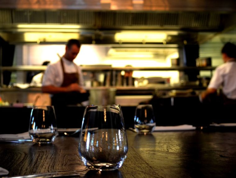 chef in open kitchen in casual dining restaurant