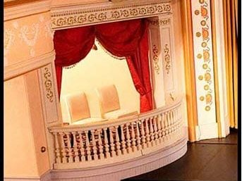 theater balcony box with red curtains
