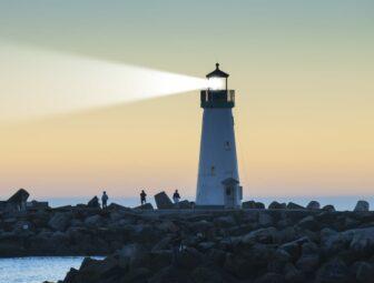 lighthouse on rocky shoreline