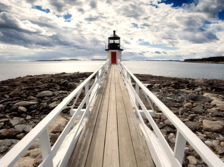 pier leading to lighthouse