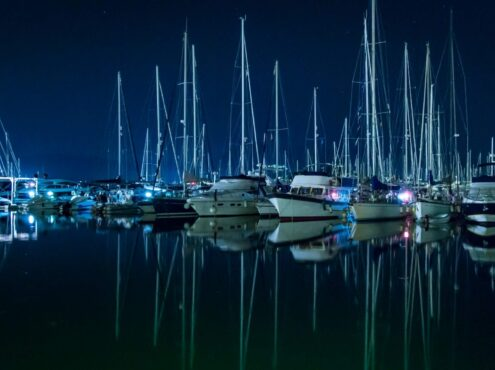 sailboats in harbor at night