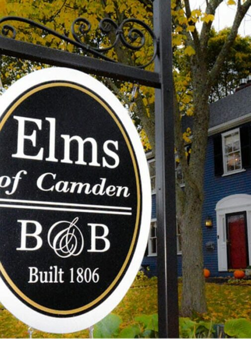 Elms of Camden B&B sign in front of building
