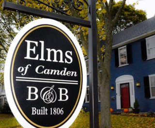 Elms of Camden B&B sign in front of building