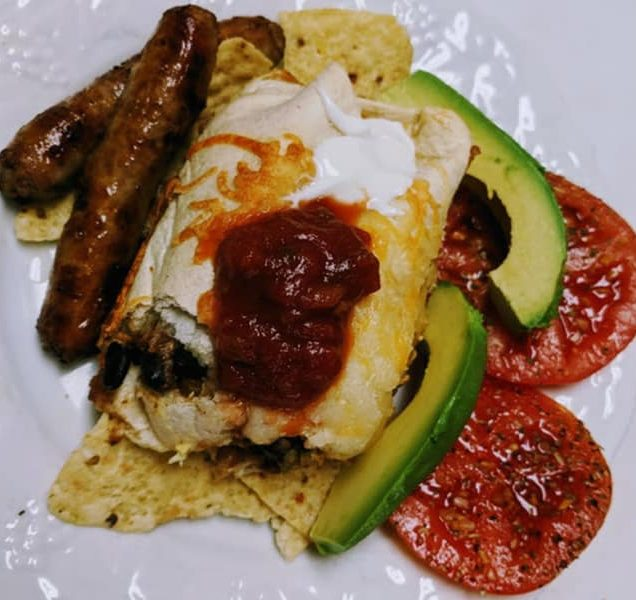 sausage links, avacados, tomatoes with crepe